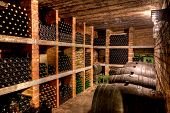 stock photo of wine cellar  - stacked up wine bottles in the cellar - JPG