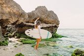 Attractive Surf Woman With Surfboard Going To Ocean For Surfing. Beautiful Sporty Woman. poster