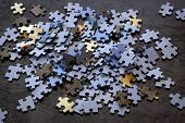 Puzzle Pieces On A Wooden Surface, Closeup, Top View. A Puzzle Is A Puzzle From Small Pieces. Textur poster