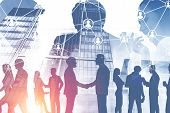 Silhouettes Of Business People Shaking Hands With Managers Figures And Double Exposure Of Skyscraper poster