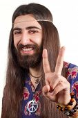 stock photo of hippy  - Friendly hippie with long hair making peace sign - JPG