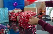 Gift Boxes With A White Bow Against A Background Bokeh Of Twinkling New Year Gift. Christmas Gift. C poster