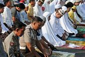 JAKARTA, INDONESIA - SEPTEMBER 20: Police officers pray with other Muslims outside a mosque in Jakar