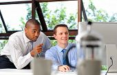 stock photo of mentoring  - African businessman mentors his white associate on how to deal with customers effectively - JPG