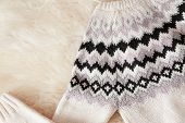 Warm Knitted Sweater On Fuzzy Carpet, Top View poster