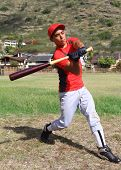 Baseball player mid-swing
