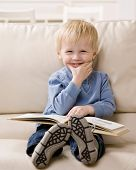 image of reading book  - Young boy enjoying reading a book - JPG
