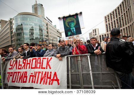MOSCOW - SEPTEMBER 15: Opposition activists and supporters take part in an anti-Putin protest on September 15, 2012 in Moscow. Thousands marched through Moscow to protest against the rule of V.Putin.