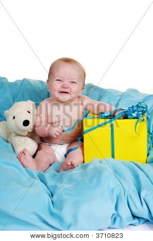 Baby With A Present And A Big Grin