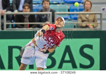 WIENER NEUSTADT, AUSTRIA - FEBRUARY 10 Andreas Haider-Maurer (Austria) beats Alex Bogomolov (Russia) in a four set match during the Davis Cup event on February 10, 2012 in Wiener Neustadt, Austria.