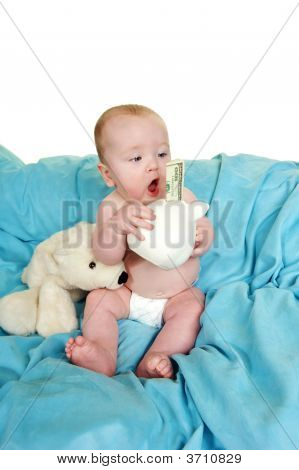 Baby Holding A Piggy Bank With 100 Dollar Bill