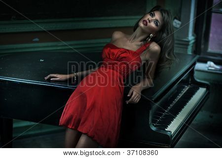 Cute woman wearing red dress