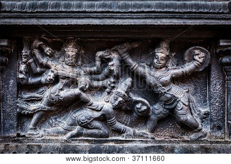 Bas relief depicting Durga slaying demon (Maheeshasuramardini). Brihadishwara Temple. Tanjore (Thanjavur), Tamil Nadu, India. The Greatest of Great Living Chola Temples - UNESCO World Heritage Site