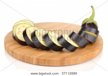 Sliced eggplant on chopping board isolated on white