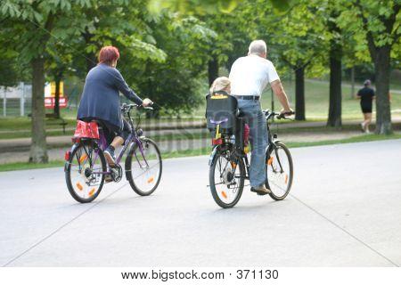 Older Couple Riding Bike