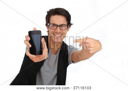 Young man showing smartphone screen to camera