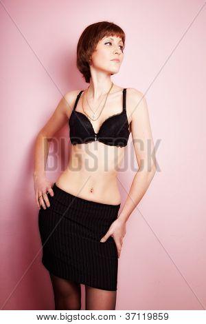 navel piercing beautiful woman. indoor shot