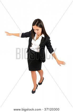 Isolated young business woman walking on rope