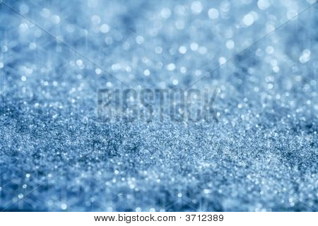 Blue Glitter Sparkles Background With Star Light