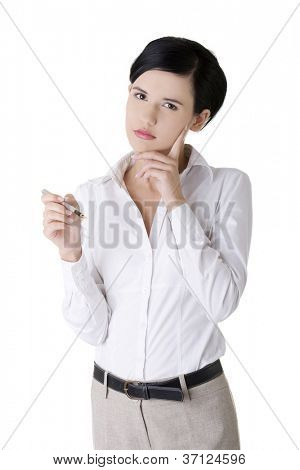 Closeup portrait of a young thoughtful business woman with pen isolated on white