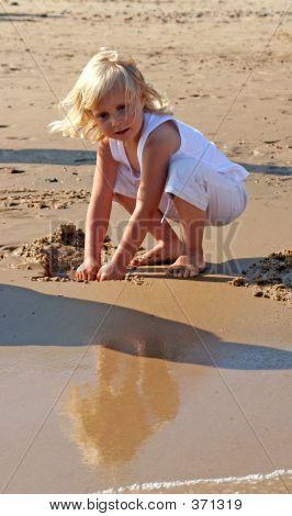 Girl Building A Sand Castle