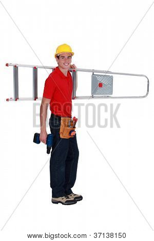 Young tradesman carrying a stepladder