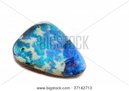 Single opal jewel on white background
