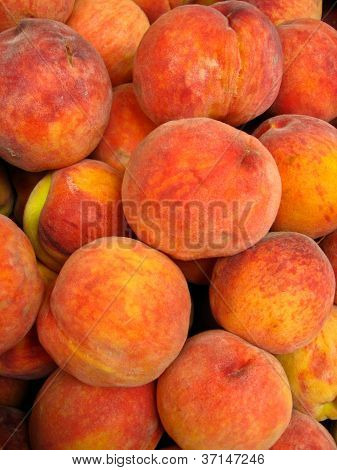 tasty peaches laying in the market