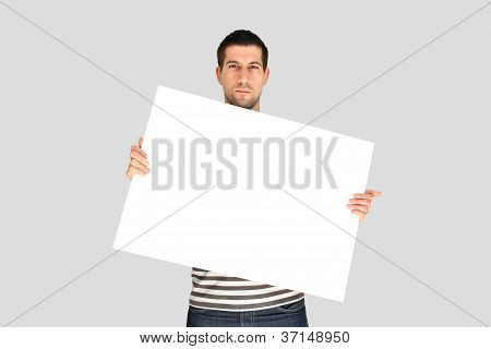 Attractive young man holding white banner