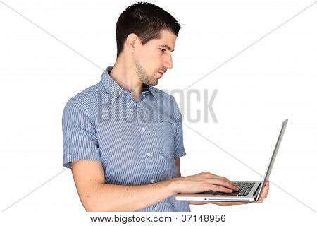 Young man using laptop on his side