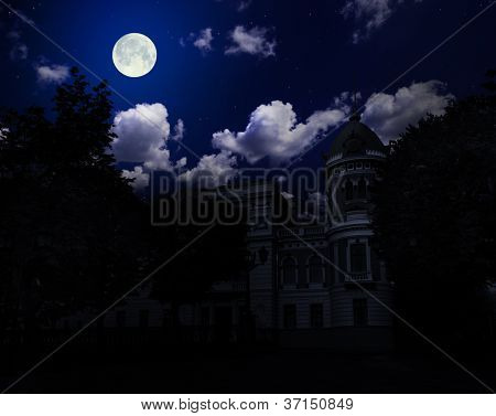 Ancient building under night sky with moon