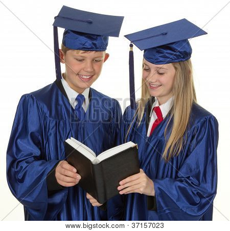 Two Graduate Children Reading A Book, Isolated On White