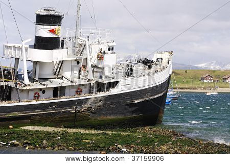Old steamship at the bay of Beagle Channel