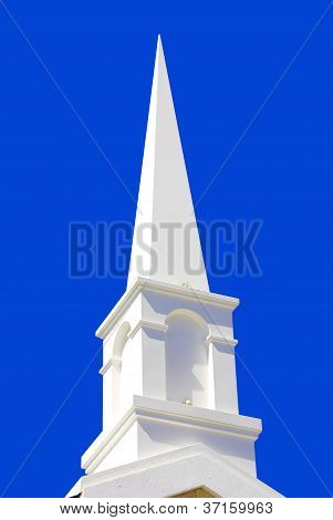 White bell tower in blue sky