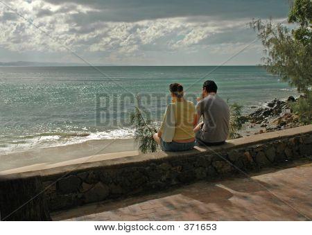 Couple Eating Ice Cream On The Beach