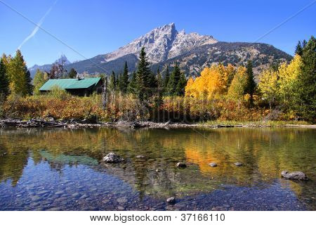 Grand tetons and Aspen reflections in autumn time