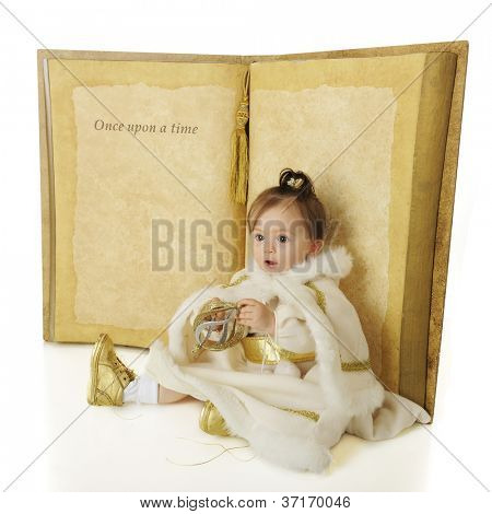 "An adorable baby ""Snow Princess"" sitting in front of a giant book opened to a page that says ""Once Upon a Time..."".  The rest is left blank for your text.  On a white background."