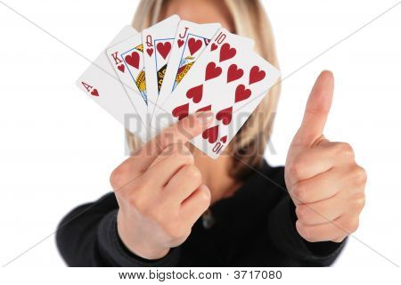 Woman Holds Cards In Hand And Does Gesture By Thumb