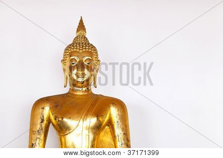 Golden Buddha Statue On White Wall