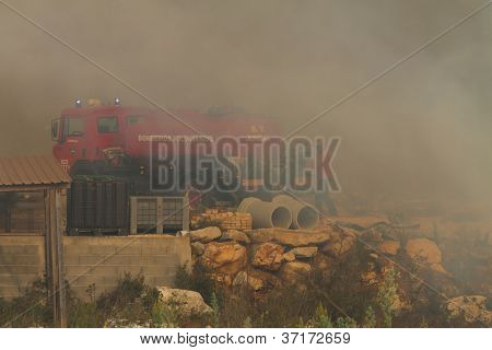 Pombal, Portugal - September 22: Firefighter Controlling Water Motor Pump On Wildfire, In Pombal, Po