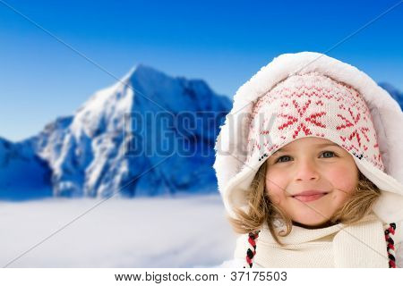 Winter, snow and sun - lovely girl on winter holiday