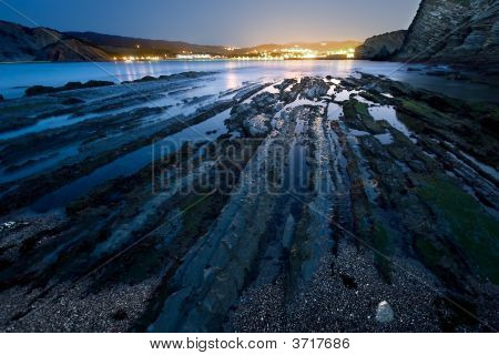 Flysch In Barrika\'S Beach Getting Dark