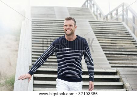 Smiling Man Walking Down the Stairs