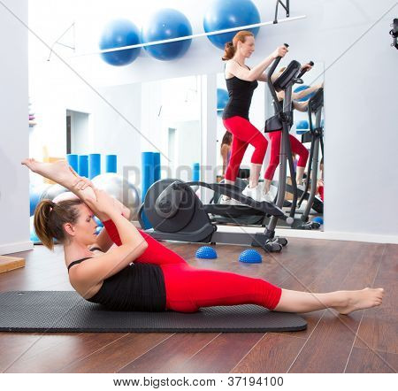 Aerobics pilates gym women group with cross trainer