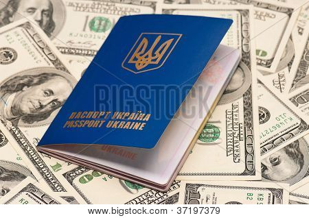 International Ukrainian passport on US dollars background