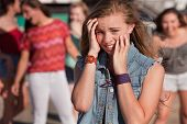 Teenagers Laughing At Scared Girl