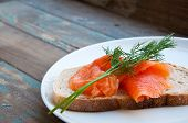 stock photo of lax  - Smoked salmon served in freshly baked sourdough bread garnished with fresh dill - JPG