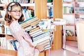 Girl holding the books pile