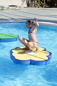 stock photo of tarzan  - Girl is playing in tarzan pool Water Park Rhodes - JPG