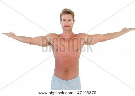 Shirtless man opening his arms on white background